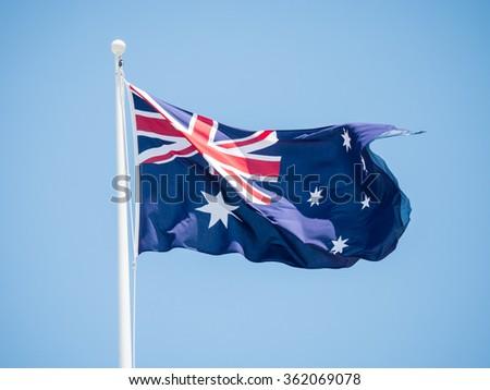 Australian flag flying on a flagpole.