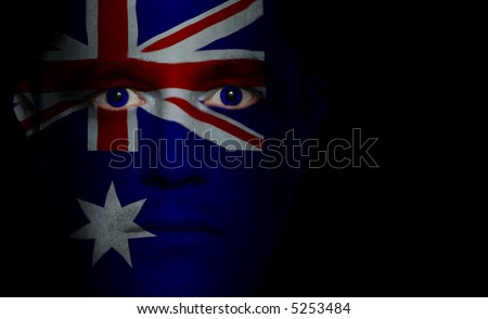 Australian flag painted/projected onto a man's face.