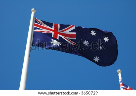australian flag waving, blue sky without clouds,
