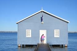 Australian girl visiting at Crawley Edge Boatshed (Blue Boat House) in Matilda Bay Perth Western Australia.