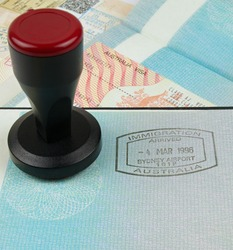 Australian immigration stamp and visa with a stamping tool