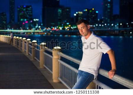 Australian man poses for picture in Brisbane, Australia. Brisbane is one of the Australia's tourist destination points.