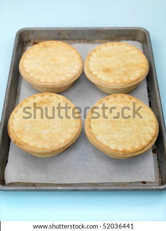 Australian meat pies isolated on a baking tray