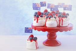 Australian mini pavlovas and flags in red, white and blue for Australia Day or national holiday party food treats, with applied faded retro style filters.