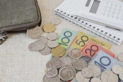 Australian money, AUD with calculator, notebook, Coronavirus economic stimulus rescue package, superannuation concept