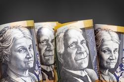 Australian money background.  Fifty dollar notes against dark background.