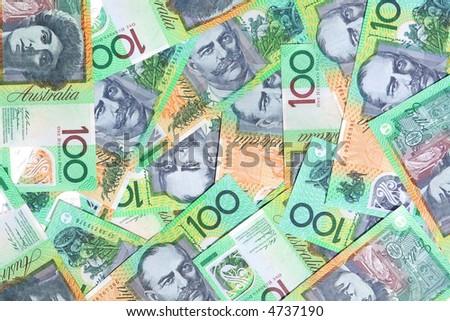Australian one hundred dollar notes make a full-frame background.