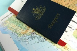Australian passport, with flight boarding pass, on map of USA west coast