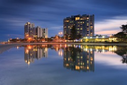 Australian suburb in front of water at night (Gold Coast, Labrador, QLD, Australia)