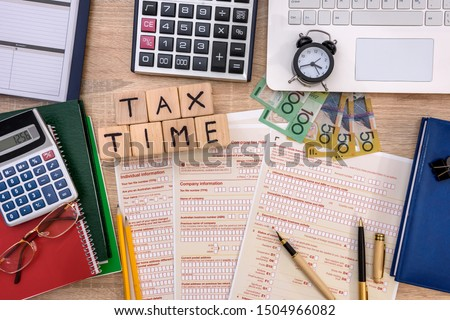 Australian 'tax time', tax form with money on table