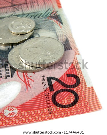 australian twenty dollars note and coins on white