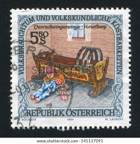 AUSTRIA - CIRCA 1994: stamp printed by Austria, shows Dolls, cradle, Vorarlberg, circa 1994