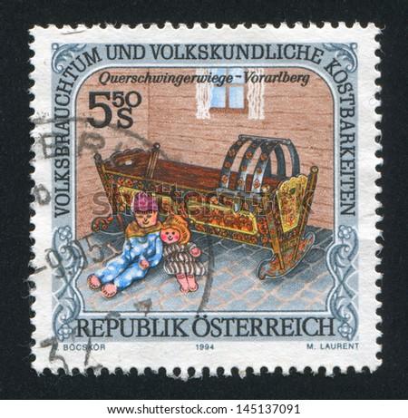 AUSTRIA - CIRCA 1994: stamp printed by Austria, shows Dolls, cradle, Vorarlberg, circa 1994