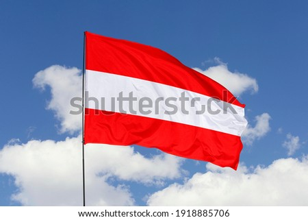 Austria flag isolated on the blue sky with clipping path. close up waving flag of Austria. flag symbols of Austria. Stock fotó ©