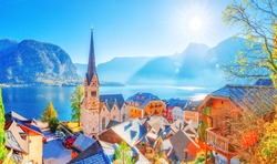 Austria, Hallstatt historical village. UNESCO world heritage site, old European architecture in sunlight. Hallstatter see in background. Hallstatt is iconic world landmark. Autumn seasonal landscape.