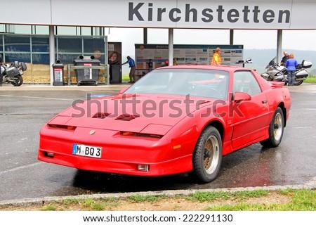 AUSTRIA - JULY 28, 2014: Retro sports car Pontiac Firebird at the interurban freeway.