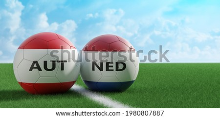 Austria vs. Netherlands Soccer Match - Leather balls in Austria and Netherlands national colors on a soccer field. Copy space on the right side - 3D Rendering