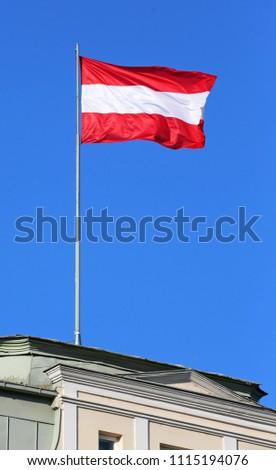 austrian flag on building #1115194076