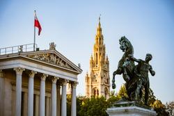 Austrian Parliament and Vienna's Historical City  Hall behind a bronze horse tamer, Vienna, Austria
