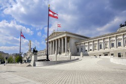 Austrian parliament building with famous Pallas Athena fountain and main entrance in Vienna, Austria