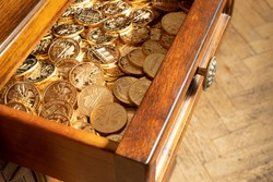 Austrian Philharmoniker pure gold coins hidden in old wooden drawer. Conservative investor's portfolio.