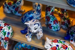 Authentic handcrafted colorful ceramic cats on shelves of souvenir shop in Istanbul Bazaar. Traditional Turkish souvenirs