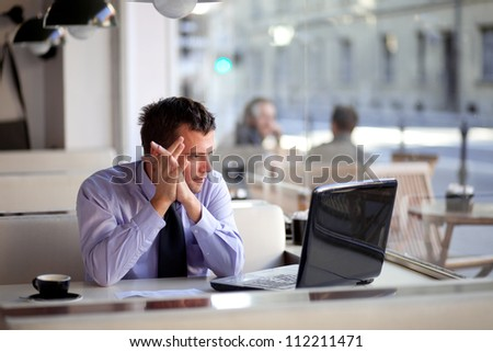 Authentic image of a pensive businessman in a coffee shop