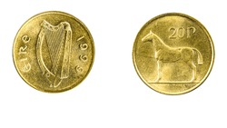 authentic Irish coin 20 pence year 1999 obverse and reverse side on white background,macro close up