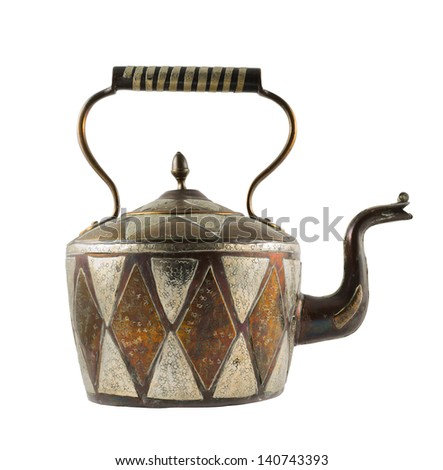 Authentic metal teapot vessel covered with ornaments isolated over white background, front view