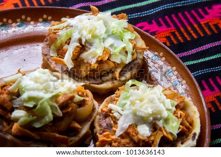 Authentic mexican sopes tinga #1013636143