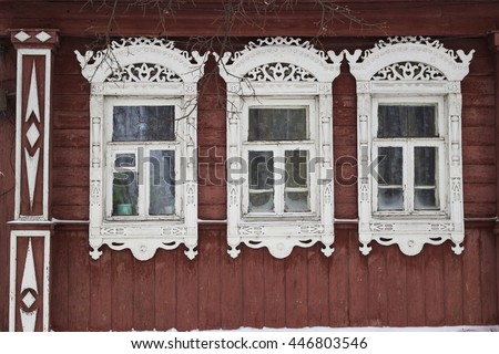Authentic Russian wooden house with carved windows and decoration in Suzdal