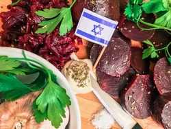 Authentic rustic kosher vegetarian israeli food cooking with dried aromatic garlic, boiled beetroot, green fresh dill and parsley and different spices wallpaper. Cooking healthy organic food in Israel