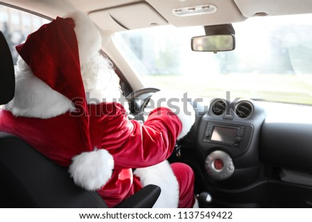 Authentic Santa Claus driving car, view from inside #1137549422