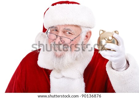 authentic Santa Claus holding gold piggy bank, Christmas budget