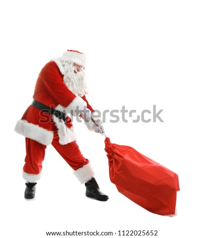 Authentic Santa Claus with red bag full of gifts on white background #1122025652