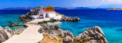 Authentic traditional Greek islands- unspoiled Chios, little church in the sea over the rocks Agios Isidoros. Eastern Aegean islands