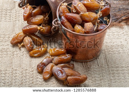 Authentic Tunisian Deglet Nour dried dates with soft honey-like taste in copper buckets