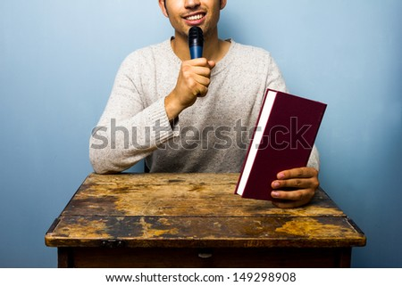 Author presenting his new book