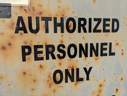 Authorized Personnel Only on rusty door