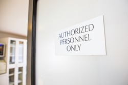 Authorized Personnel Only sign at oral surgery dental medical office practice sterilization room staff equipment and instrumentation area
