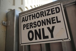 Authorized personnel only sign on gate