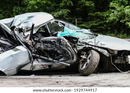 Auto accident. Crashed car in the street. Damaged car after collision