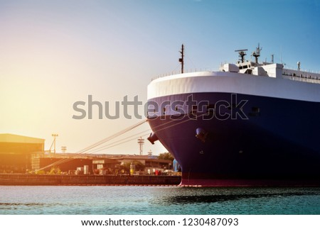 Auto car carrier ship, Car shipping Closeup forward ship, with rope, out of trade port quay wall,