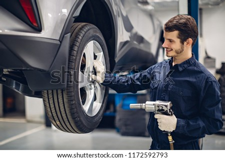 Auto car repair service center. Mechanic at work #1172592793