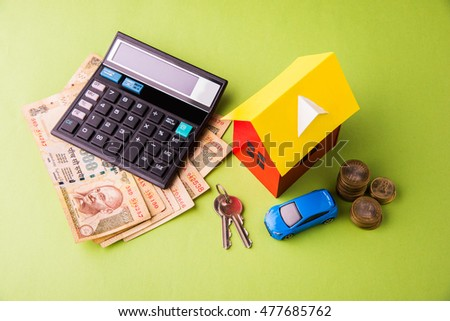 Auto Finance and Housing Loan or purchase in India -  Concept showing 3D Car and house model, keys, indian currency notes and calculator etcAuto Finance and Housing Loan or purchase in India -  Concep