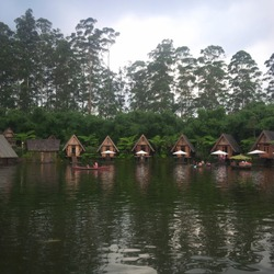 Auto focus of Beautiful Panorama of a lake surrounded by wooden houses with boats in Bamboo Village (Dusun Bambu) at Lembang, Bandung, Indonesia.