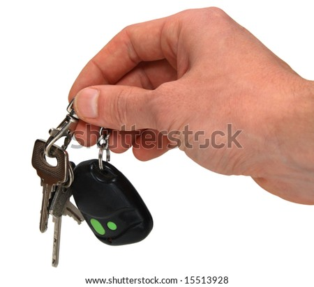 auto keys in hand isolated on white