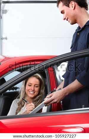 Auto mechanic and a client woman. Car repair service.