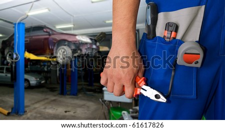 Auto mechanic closeup standing in his workshop