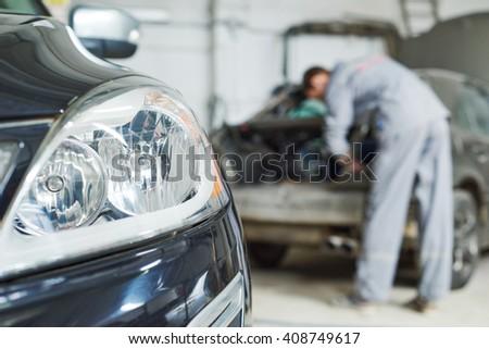 auto mechanic repair car in garage